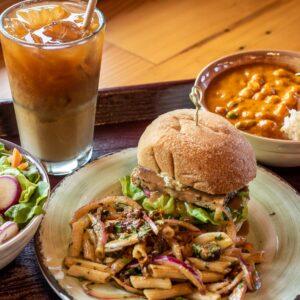 Green Salad, Tempeh Slider, Mediterranean Pasta Salad, and Chickpea Masala and Rice